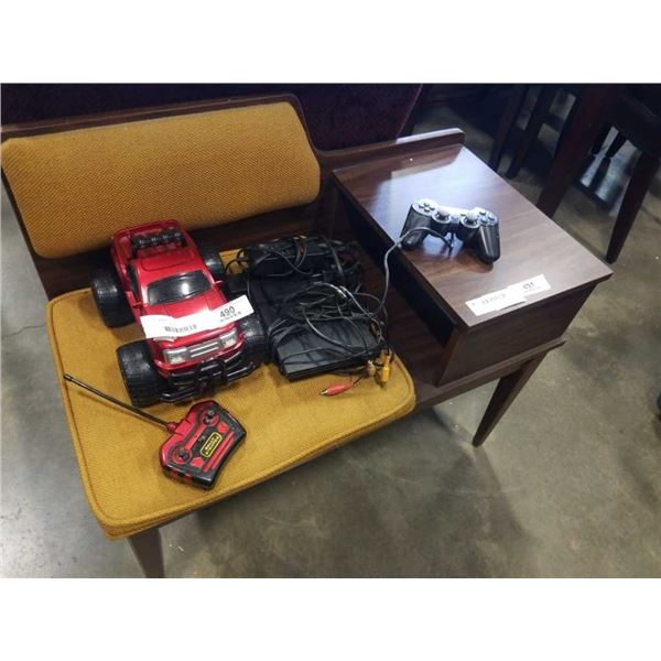 PS2 CONSOLE AND RC TRUCK