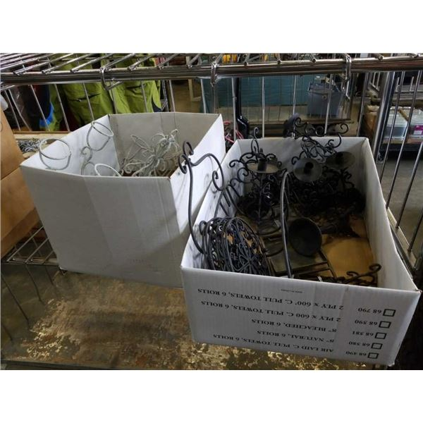 Two boxes of new decorative metal cooling trays, candle holders and more