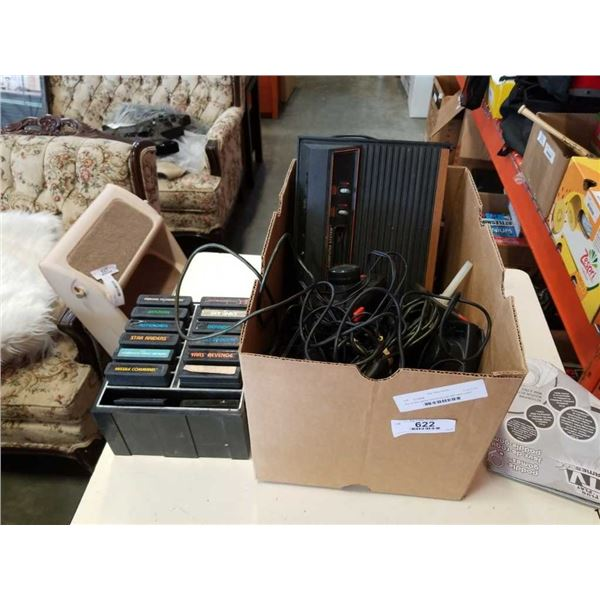 Box of atari games and accesories with xbox controllers