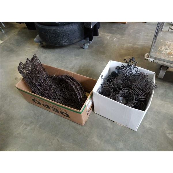Two boxes of woven trays and decorative metal plant holders
