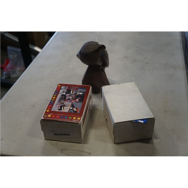 Carved eagle and 2 boxes of hockey cards