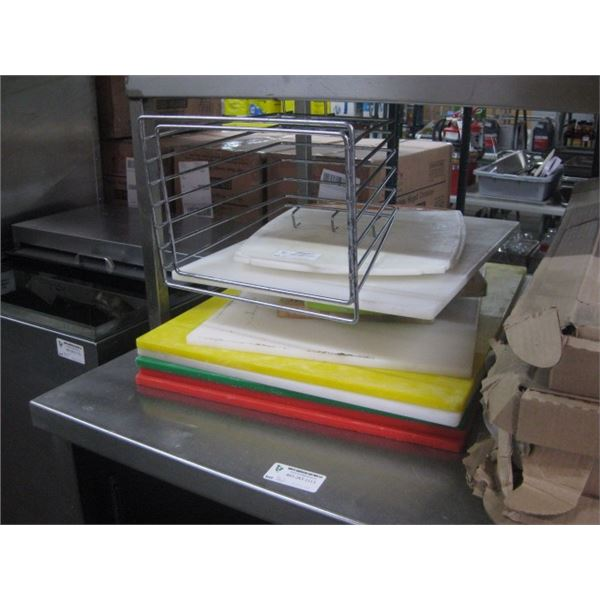 LARGE STACK OF CUTTING BOARDS AND HOLDER