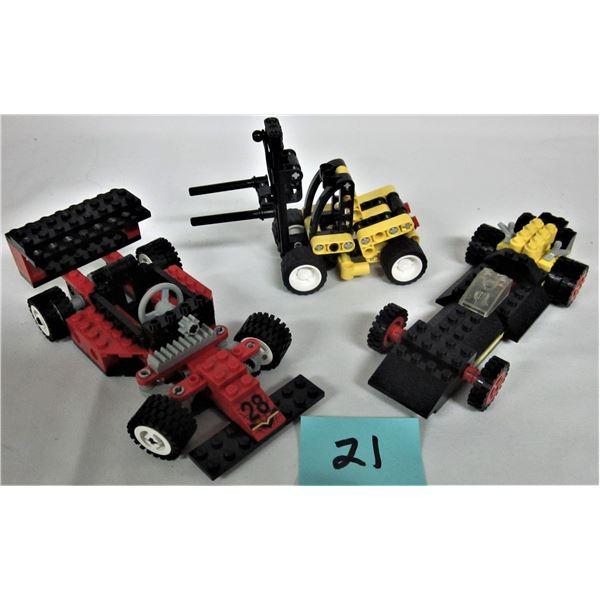 3 vintage Technic Lego sets - 1977 #491 Formula Racer, 1994 #8808 F1 racer, 2003 #8441 Fork Lift tru
