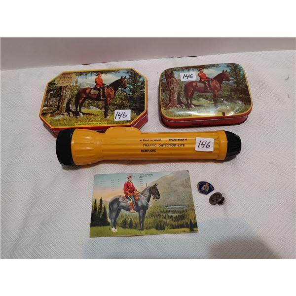 2 RCMP tins, flash light, post card & buttons