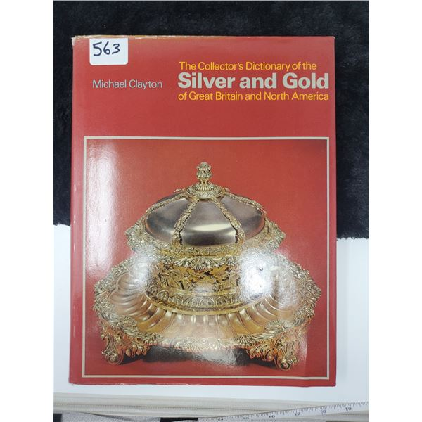 silver & gold coloured dictionary