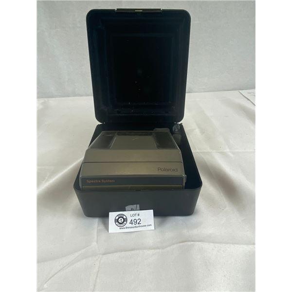 Vintage polaroid camera in hard plastic case