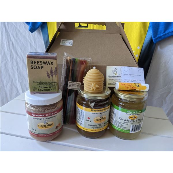 THE GIFT BASKET INCLUDES:  HONEY STIX - VARIETY PACK CLOVER HONEY & LAVENDER SOAP BAR BEESWAX CANDLE