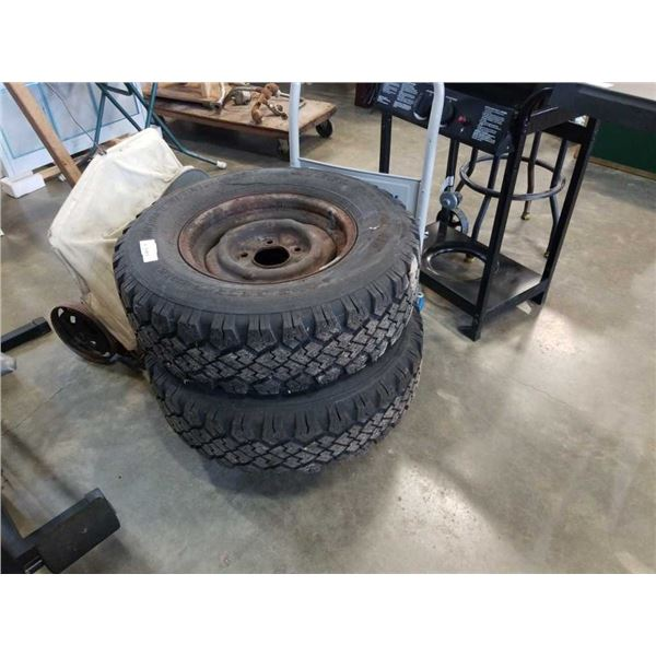2 WINTERMARK P235/75R15 TIRES ON 5 BOLT RIMS MUD AND SNOW TIRES