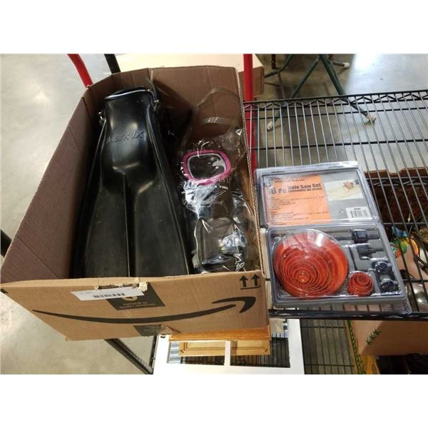 Box of new hole saw kit and flippers with facemask