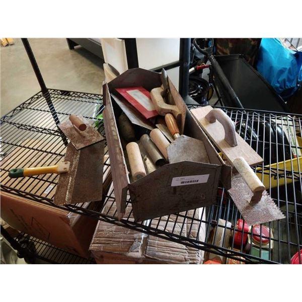 Metal toolbox of drywall trowels