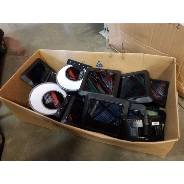 Box of store returned weather stations and electronics