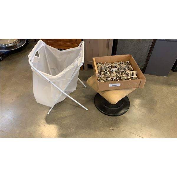 Box of new cabinet hinges, footstool and folding hamper