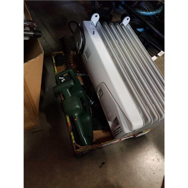 Box of tools with hedger, vacuum and oil heater