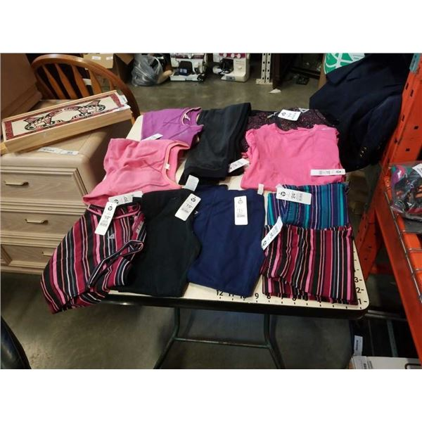 Lot of brand new size L(8-9yrs) clothing