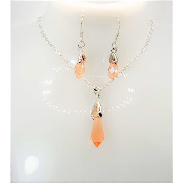 22)  PEACH COLORED SWAROVSKI CRYSTAL