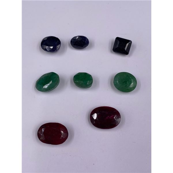 POLISHED AND FACETED ROUGH GEMSTONES; RUBY 22.90CT, SAPPHIRE 18.40CT, EMERALD 18.80CT
