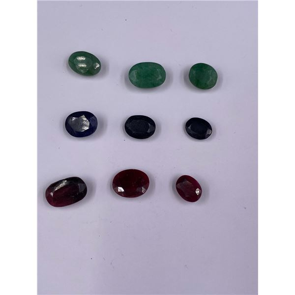 POLISHED AND FACETED ROUGH GEMSTONES; RUBY 22.50CT, SAPPHIRE 15.65CT, EMERALD 17.40CT