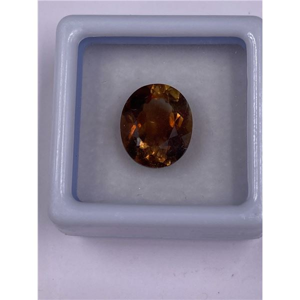 INVESTMENT IMPERIAL TOPAZ 6.08CT, 12.07 X 10.17 X 6.60MM, IMPERIAL WHISKEY COLOUR, OVAL CUT,