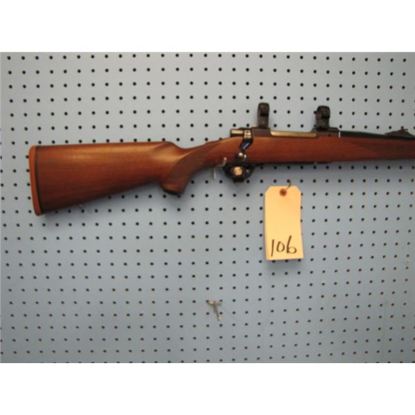 Ruger M77, bolt action, 7mm rem mag, floor plate,rings and sights