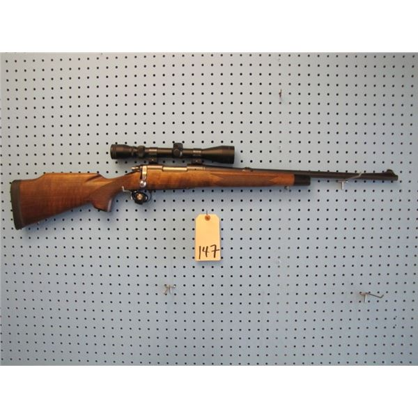 Remington Model 722, bolt action, 257 Roberts AI, hinged floor plate, in Remington model 700 stock,