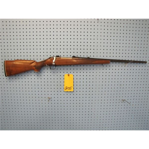 Mossberg model 810 - AH, bolt action, 30 - 06, hinged floor plate, 22 inch barrel, scope mounts, man