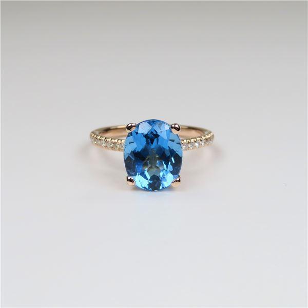 Brilliant Rose gold Blue Topaz and Diamond Ring