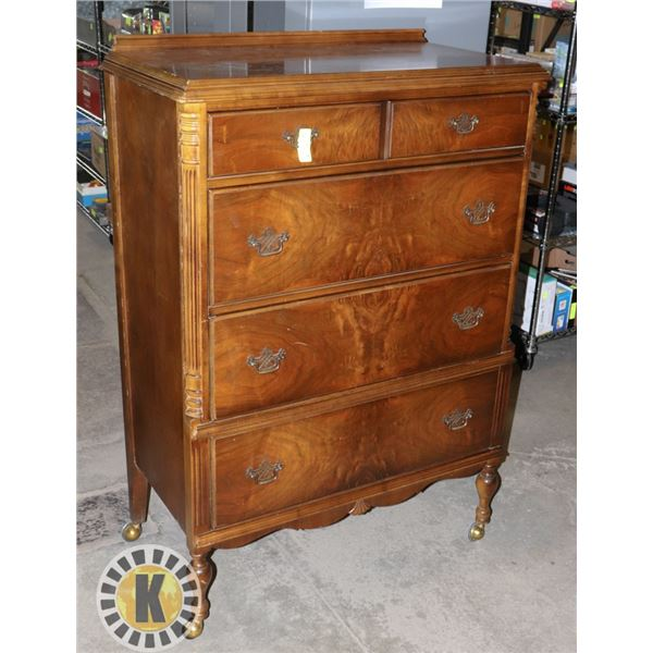 WOOD FOUR DRAWER DRESSER WITH DETAILED WOODWORK