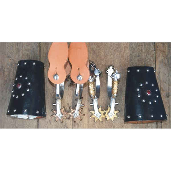 2 pairs of kids spurs and spotted kids cuffs