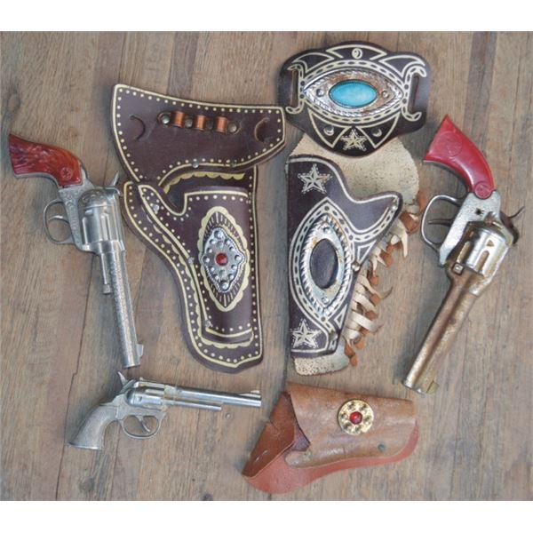 Hubley cap gun and holster, Rodeo cap gun and holster, and Pet gun & holster