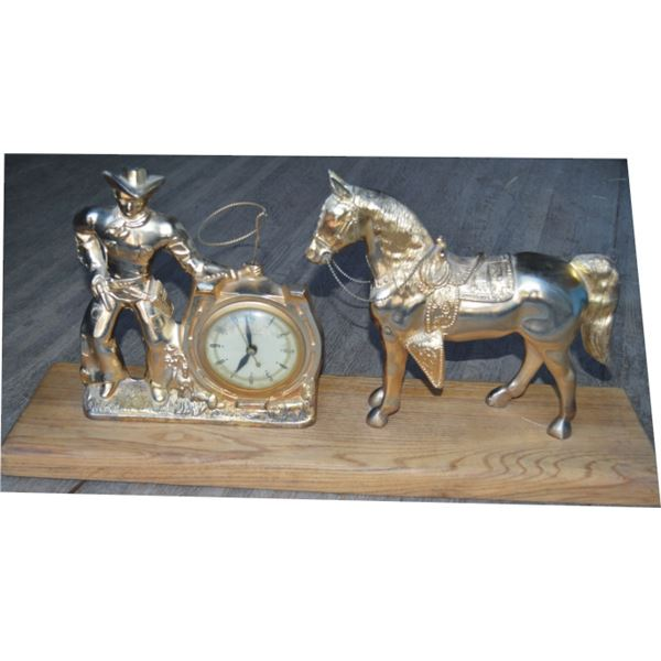 bronze cowboy and horse clock