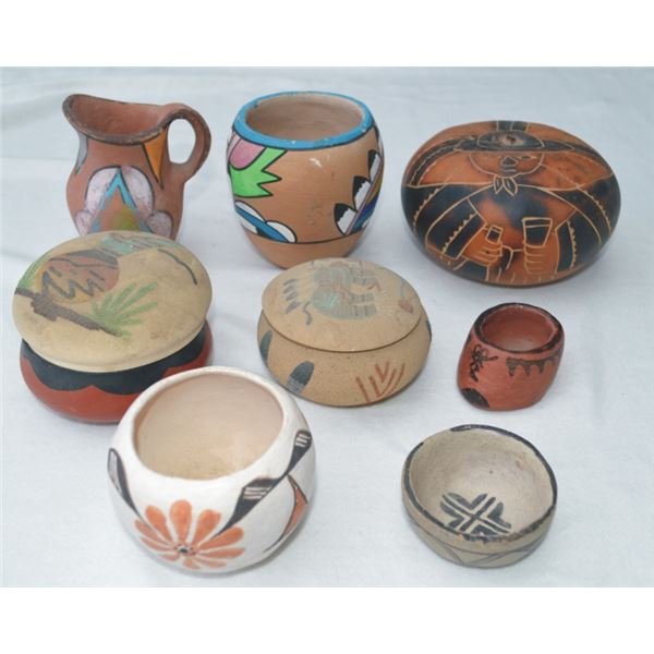 grouping of small south west pots