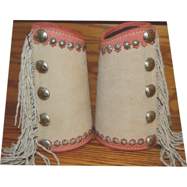spotted and fringed cowboy cuffs