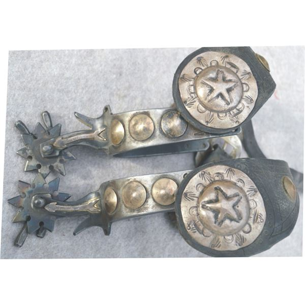 double mounted spurs marked MGC