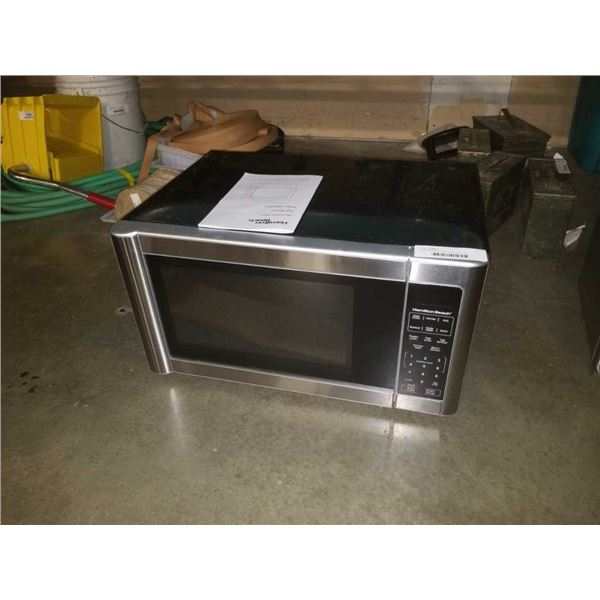 As new hamilton beach microwave oven EM031MC1 - 11 1/2 INCHES TALL X 21 INCHES WIDE X 16 INCHES DEEP