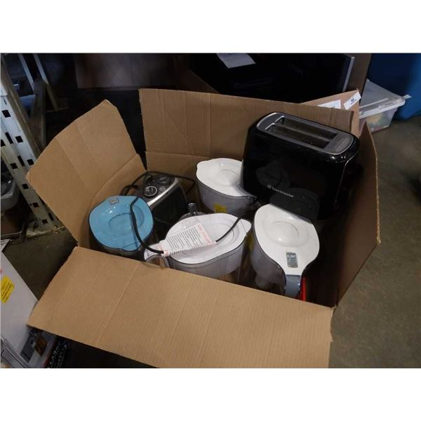 Box of store return water jugs/filters and toaster