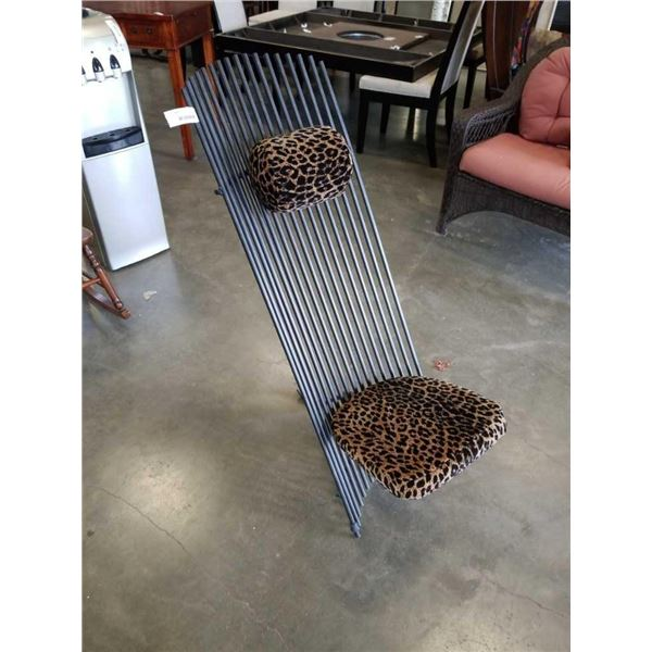 HEAVY METAL DESIGNER CHAIR WITH LEOPARD PRINT CUSHION AND HEADREST