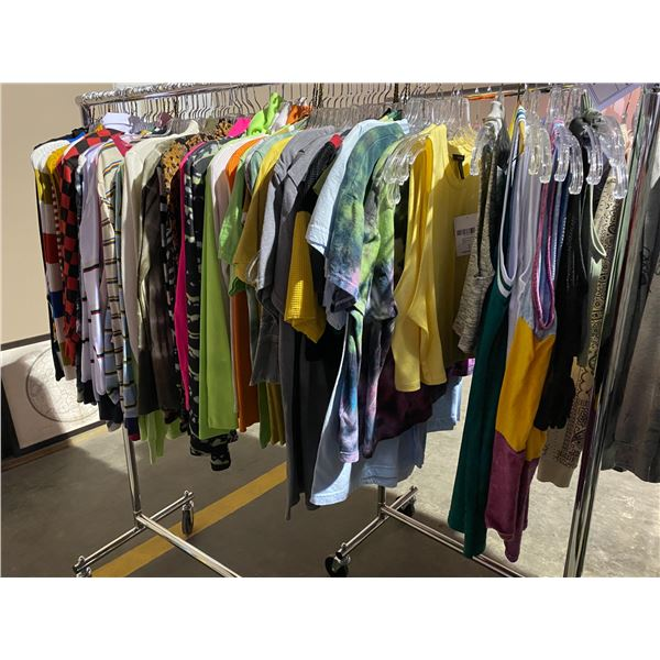 ASSORTED CLOTHING BRANDS SUCH AS : TOP SHOP, TNA, JADED, & MORE RACK INCLUDED