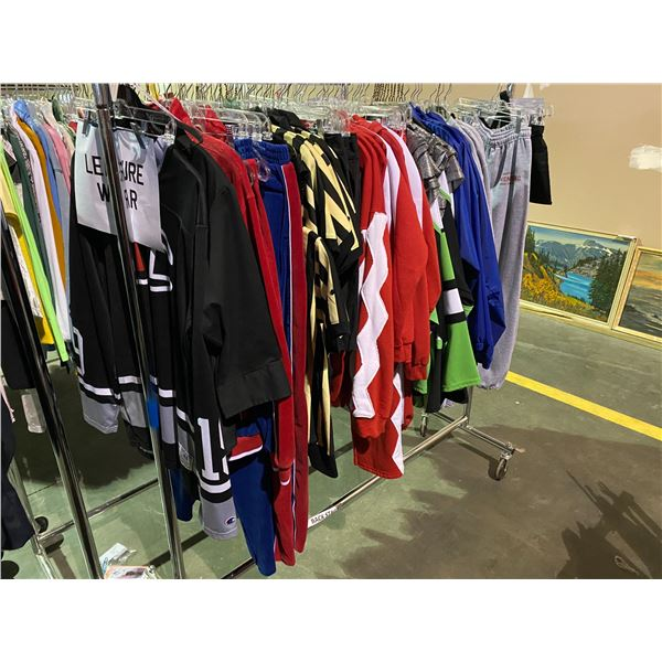 ASSORTED CLOTHING BRANDS SUCH AS : CHAMPION, GILDAN, EDDIE BAUER, & MORE RACK INCLUDED