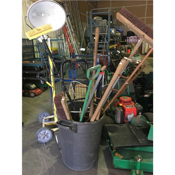 BIN OF ASSORTED SHOVELS, BROOMS, AND GREY 2 WHEELED DOLLY