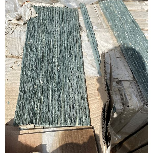 A pallet of green stone tiles