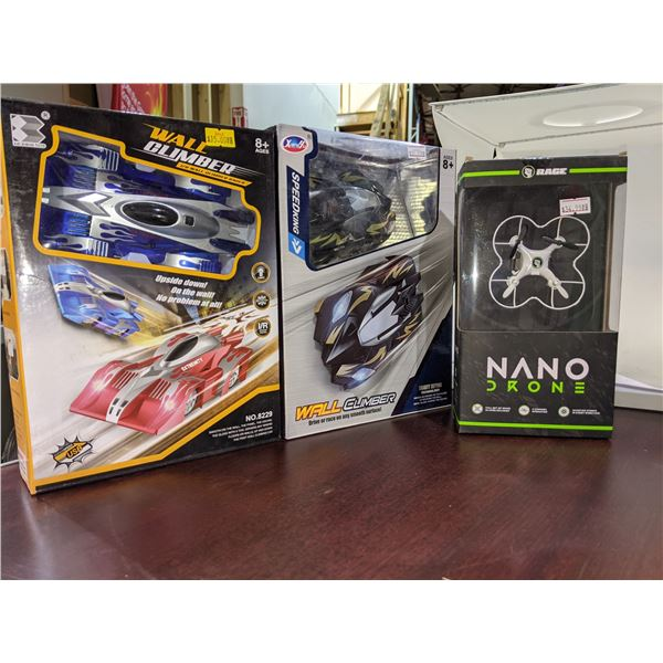 lot of for toys including Nano drone two wall climbers and transforming toy