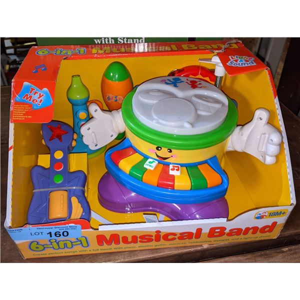 Lot of two toys including six in one musical band and old fashioned gumball machine and Bank with s