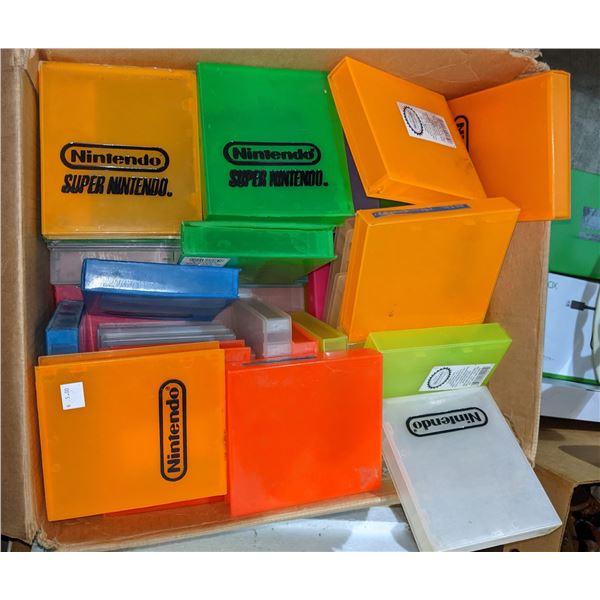 box of assorted Super Nintendo Nintendo plastic cases