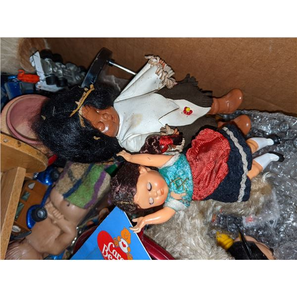 box of a box of assorted toys and magazines