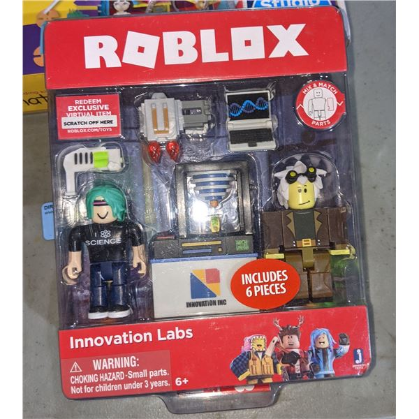 five boxes of assorted toys including Transformers Roblox