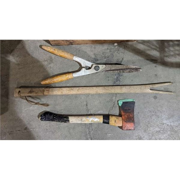 a box lot of tools (appears to be vintage) including axes, gardening tools and more