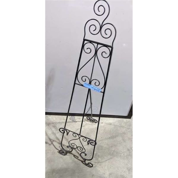 Metal sign stand and a metal coat hanger