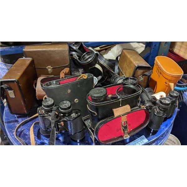 large lot of vintage binoculars and a flash light