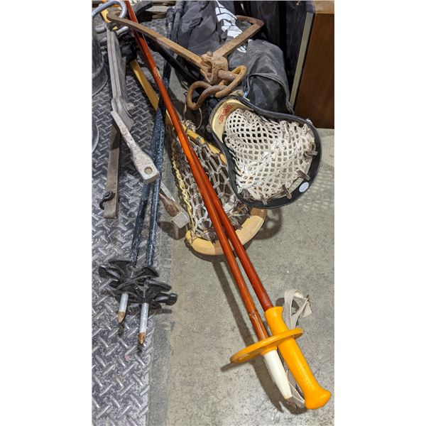 two pair of ski poles, a Lacrosse stick, 2 ice tongs