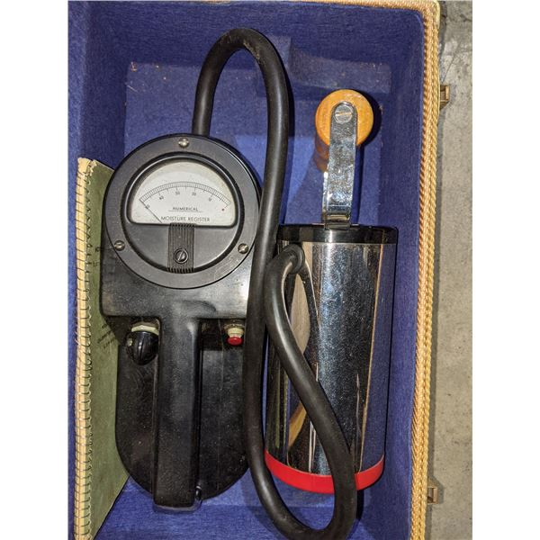 Vintage moisture register, Warren Knight Sterling transit Compass stand and a box of reel & can set